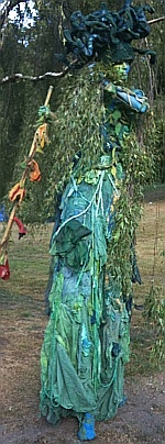beautiful green stilt walker